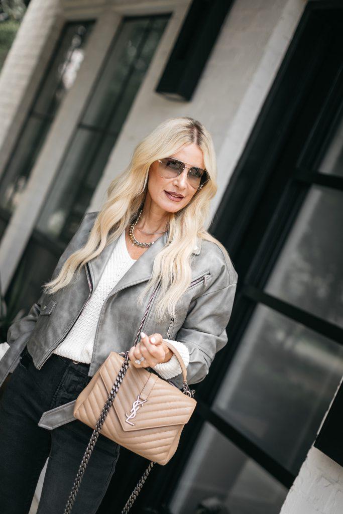 So Heather Blog wearing a grey leather jacket and a neutral YSL handbag