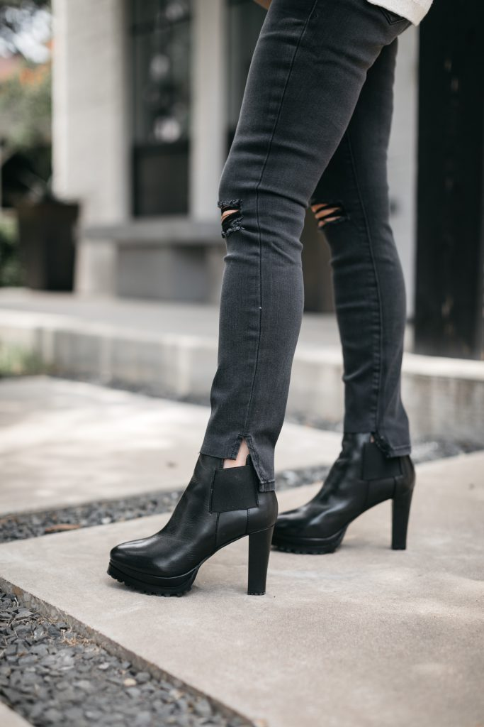 Dallas bloger wearing black ripped denim and booties from the NSALE