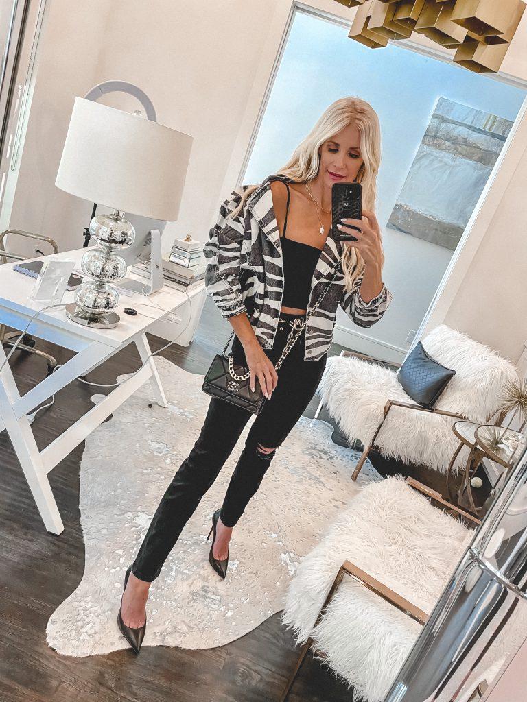 Dallas blogger wearing a zebra print jacket and black denim