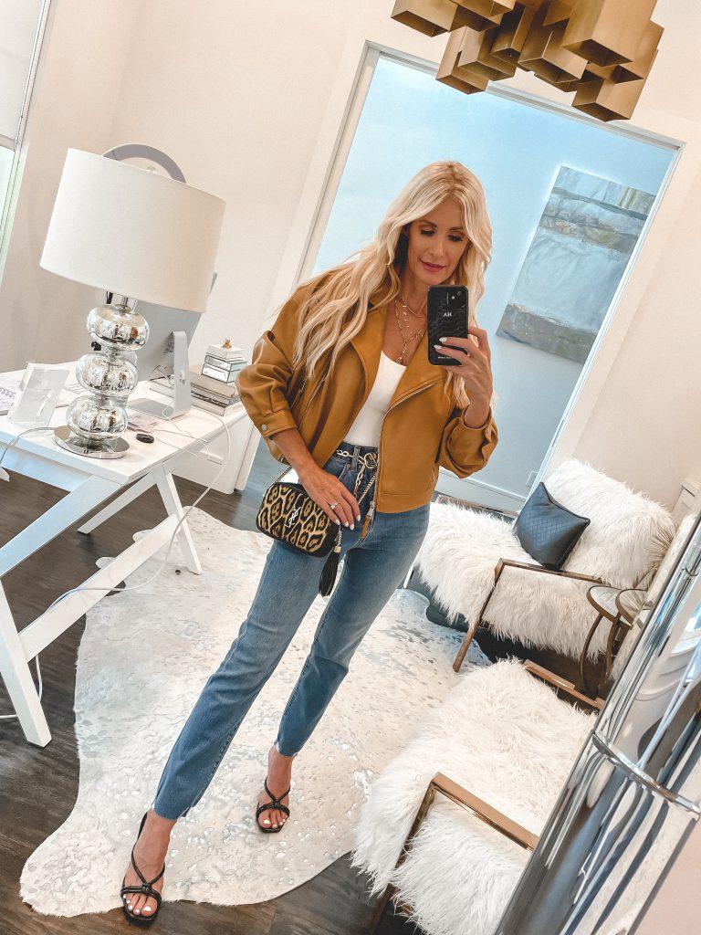 Dallas fashion blogger wearing a leopard handbag and a camel moto jacket