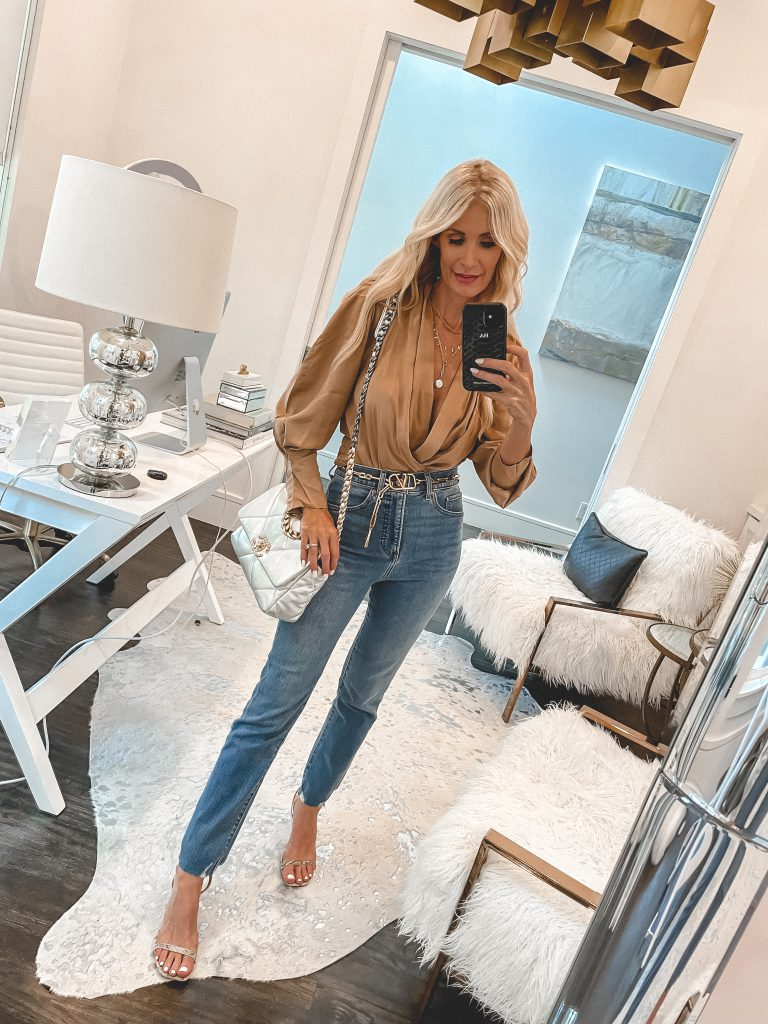 Dallas style blogger wearing a gold top and straight leg denim