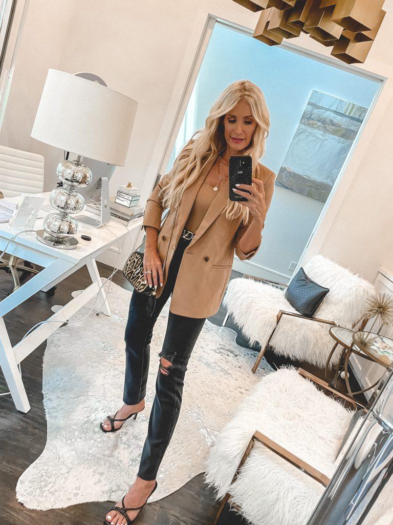 Dallas style blogger wearing a camel blazer and black distressed denim