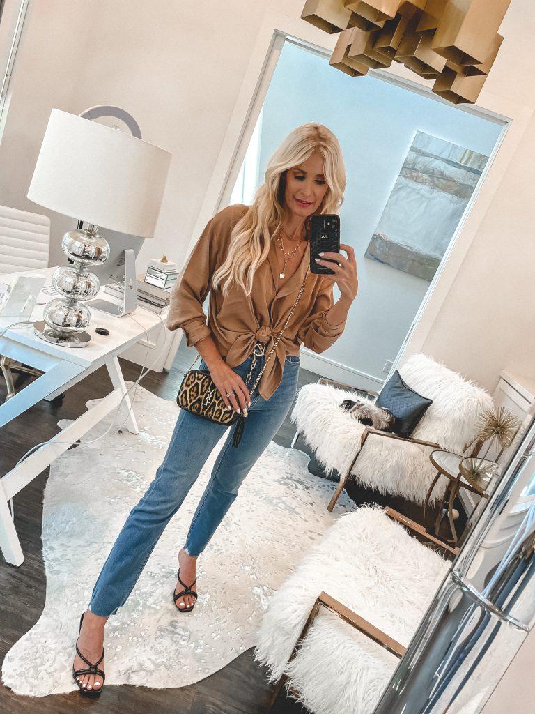 Dallas style blogger wearing a silk top and a leopard handbag