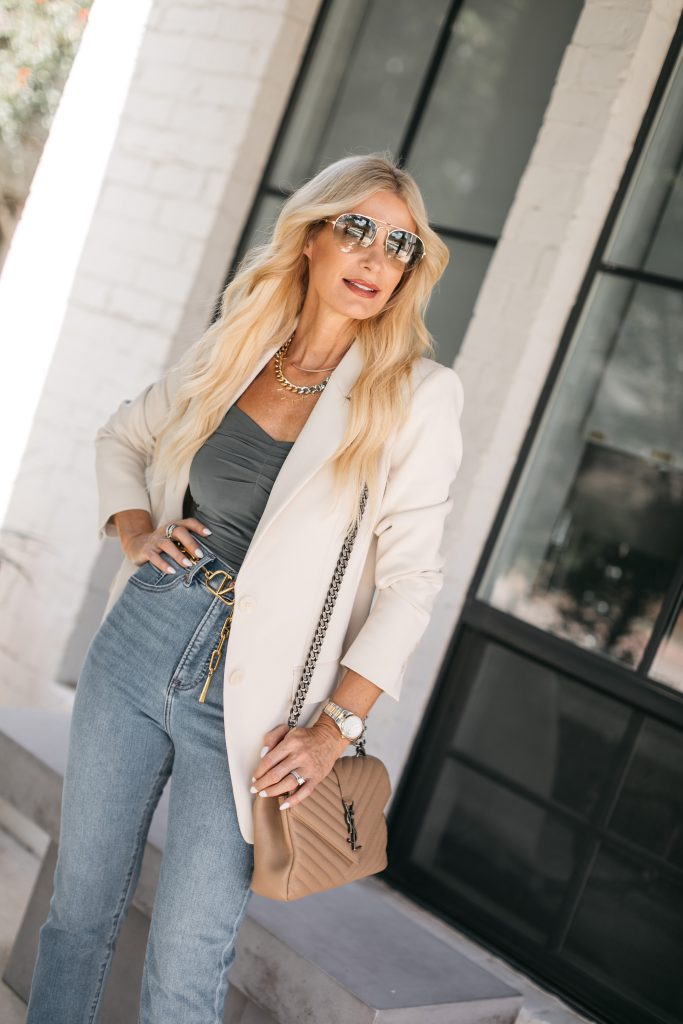 Dallas style blogger wearing his waisted denim and a cream blazer