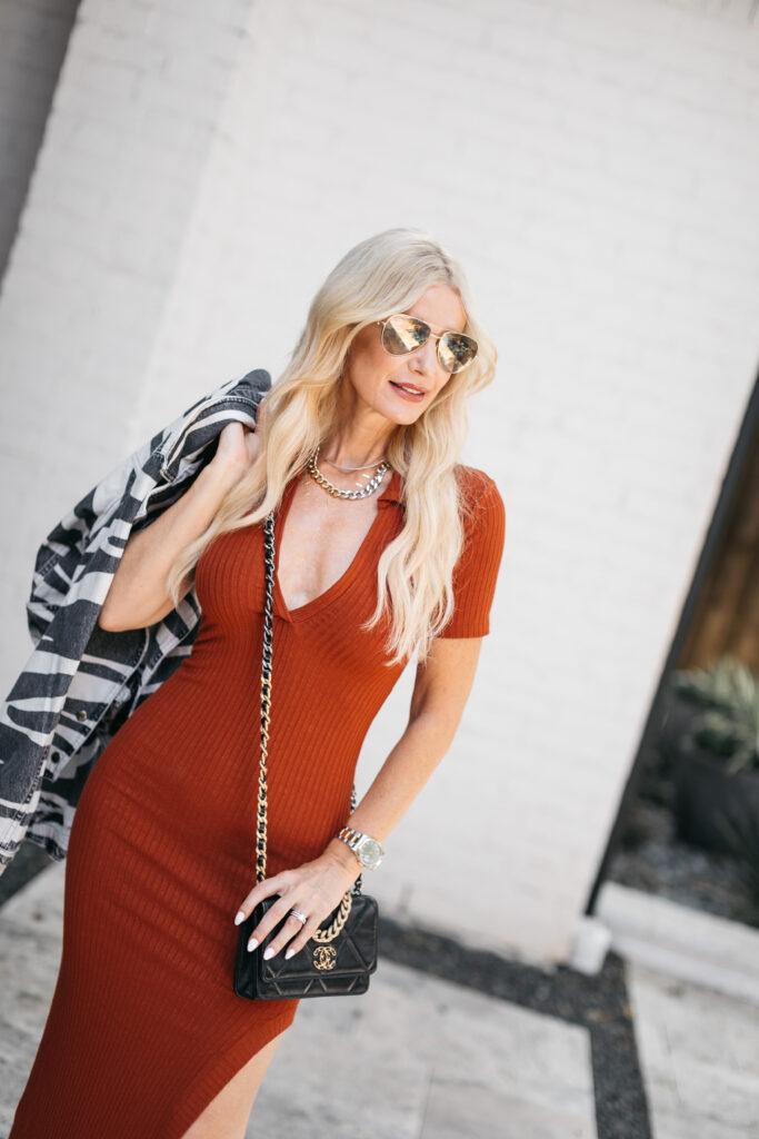 Dallas fashion blogger wearing an orange dress
