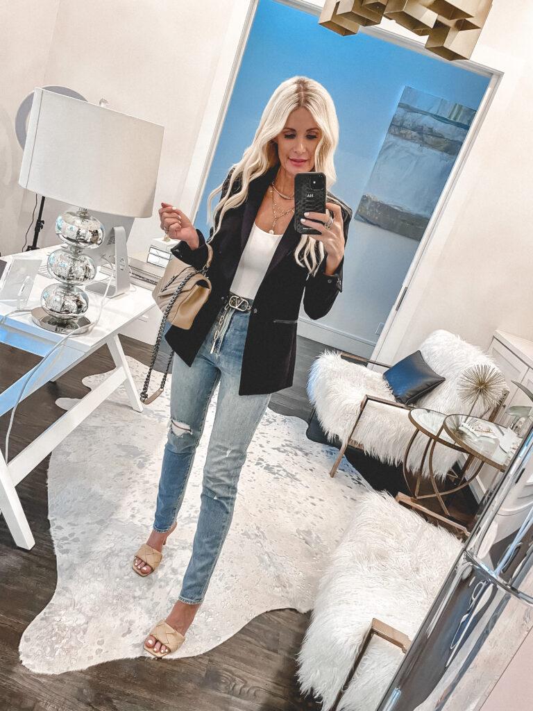 Dallas style blogger wearing a black blazer and a white bodysuit