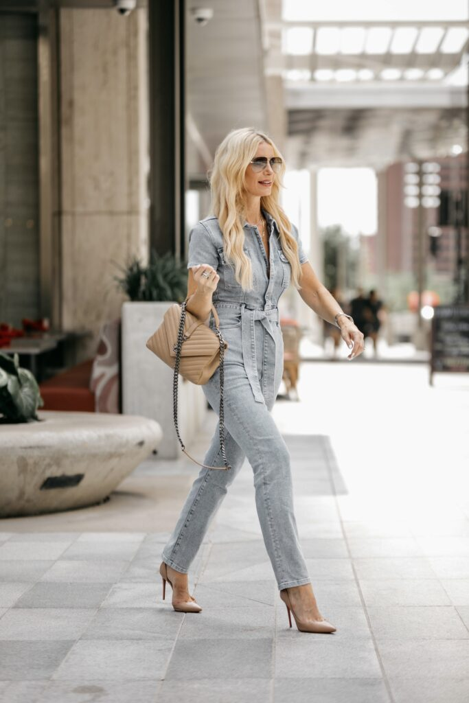 Dallas fashion blogger wearing a chic denim jumpsuit